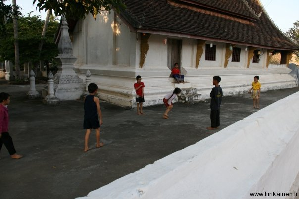 children on temple courtyard luang prapang