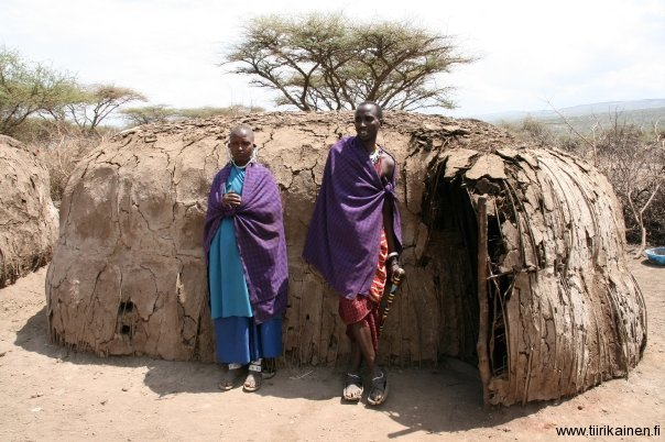 masai couple in front of their house in Ngorongoro