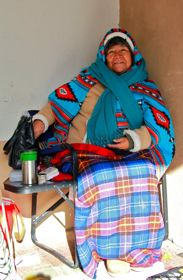 pueblo native american lady selling her selfmade jewels in Santa Fe New Mexico